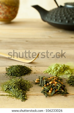 Different sorts of Japanese green teas in leaf form and powder - stock photo