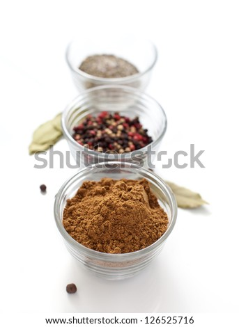 Different spices in glass cups