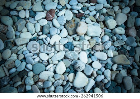 Different stones pebble beach. - stock photo