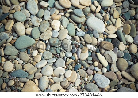 Different  stones pebble beach. Toned. Selective focus. - stock photo