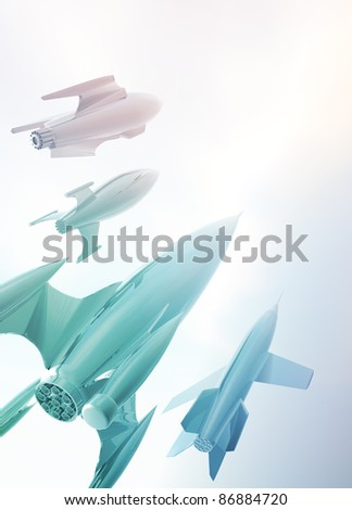 Different styled retro rockets on a misty backdrop. - stock photo