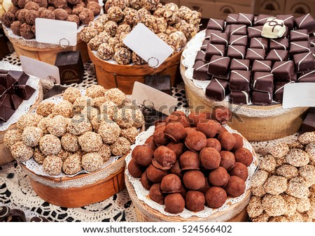 different sweet candy (round chocolate, coconut, caramel, nut) in the shop