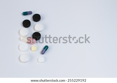 Different tablets pills capsule heap mix therapy drugs doctor flu antibiotic pharmacy medicine  - stock photo