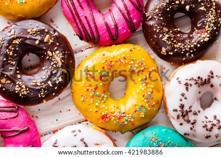 Different tasty donuts on a white background top view - stock photo