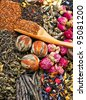 different tea types : green, black, floral , herbal rooibos with bamboo spoon - stock photo