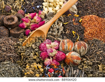 different tea types : green, black, floral , herbal  with bamboo teaspoon background - stock photo