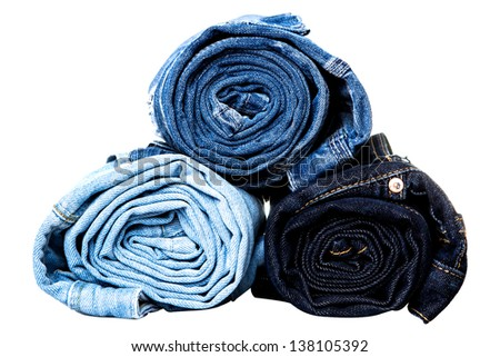 different tipes of jeans rolled isolated - stock photo