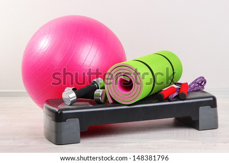 Different tools for fitness in room - stock photo