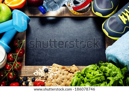 Different tools for sport and diet food - sport, health and diet concept - stock photo