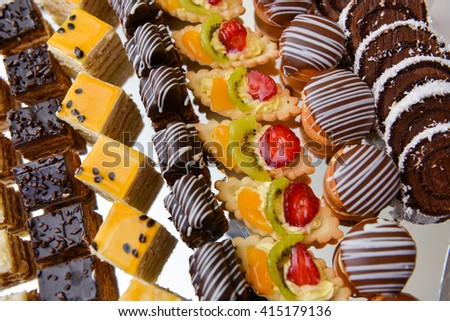Different type of cakes with chocolate, vanilla and fruits - stock photo