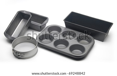 Different types of baking pans and moulds for cake, bread and muffins. - stock photo