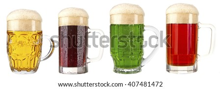 Different types of beer in mugs, isolated on white - stock photo