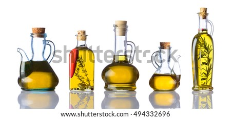 Different types of Bottles of extra virgin cooking Oil isolated on white background. Olive Oil and sunflower oil