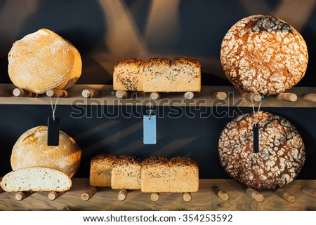 Different types of bread exposed in a bakery  - stock photo