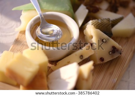Different types of cheese on a plate - stock photo