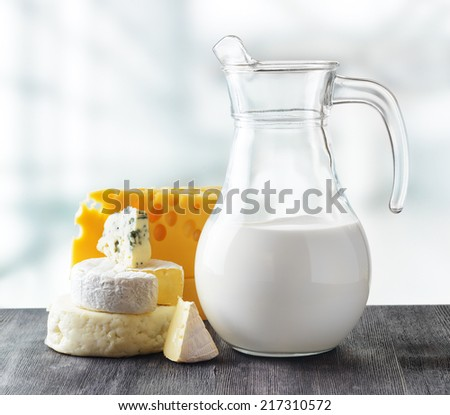 Different types of cheese on nature background. - stock photo