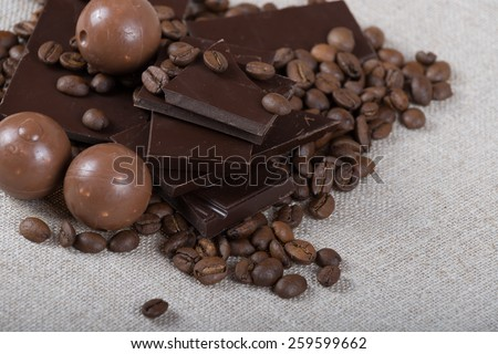 Different types of chocolate and coffee beans - stock photo