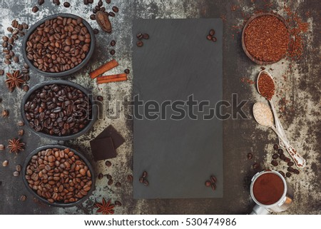 Different types of coffee with slate blackboard.  Top view, blank space, vintage toned image