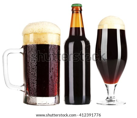 Different types of  dark beer in glass, mug and bottles, isolated on white - stock photo