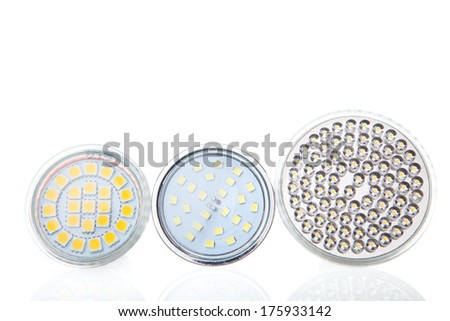 different types of LED energy saving lamps on white background - stock photo