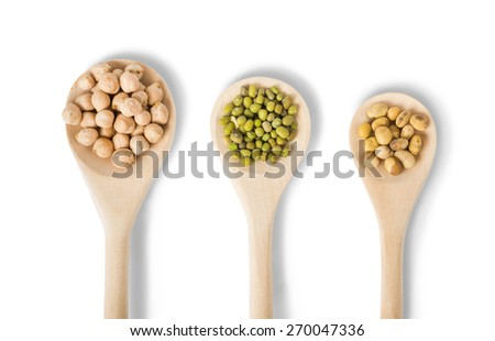 Different types of legumes in a wooden spoons isolated on white background: soybeans, mung beans and chickpea  - stock photo