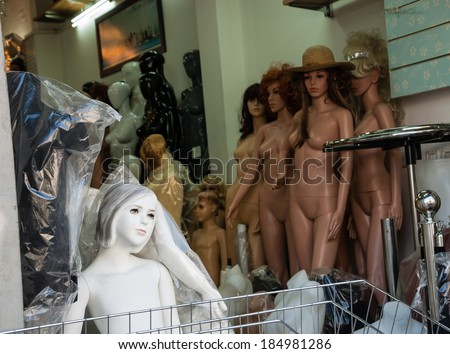 "Different types of naked mannequins for sale. Metaphor of alienation, estrangement and break up of the people in modern ""plastic"" world. - stock photo"