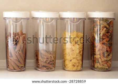 Different types of pasta in plastic containers - stock photo