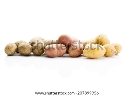 Different types of potatoes on white background - stock photo