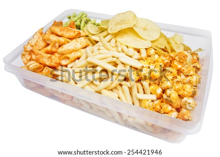 different types of snack in a plastic box - stock photo
