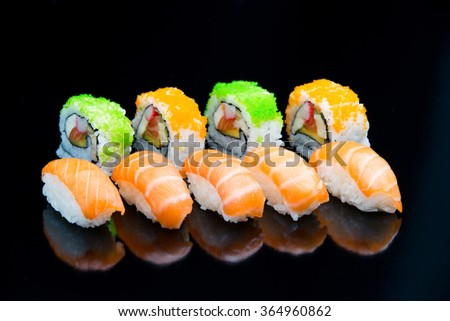 Different types of sushi. Nigiri, uramaki. - stock photo