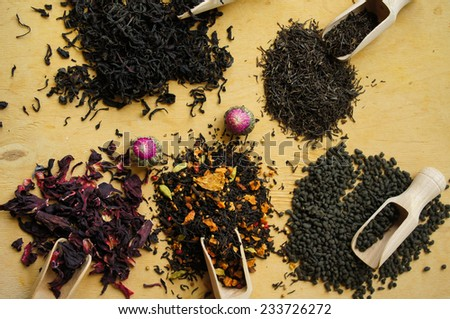 Different types of tea on the wooden background - stock photo