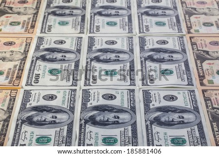 Different U.S.dollar banknotes on the table
