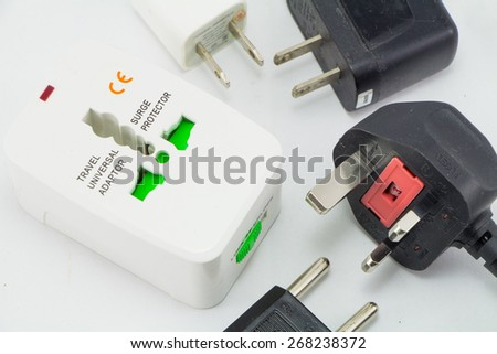 different universal adapters Travel adapters isolated - stock photo