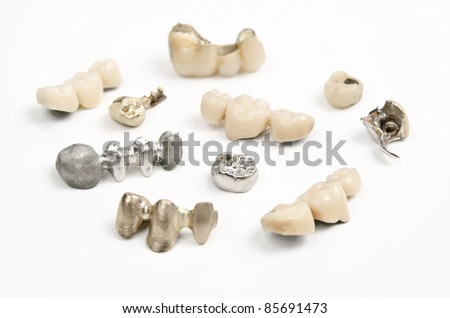 different used dental bridges and crowns - stock photo