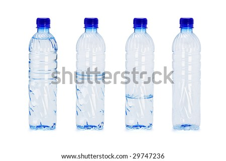 Different water levels in plastic bottles on white background - stock photo