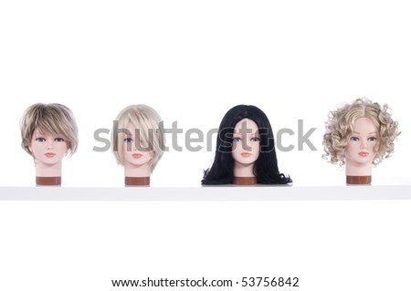 Different wigs on mannequins - stock photo