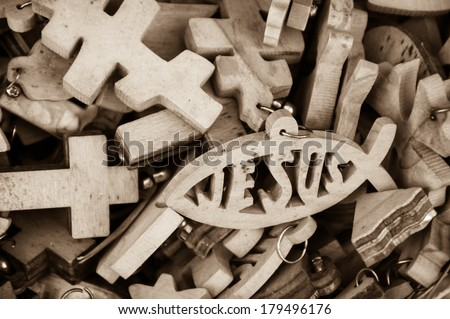 Different wooden crosses and Jesus fish symbol for sale at market in Old City of Jerusalem (Israel). Retro aged photo. Sepia. - stock photo