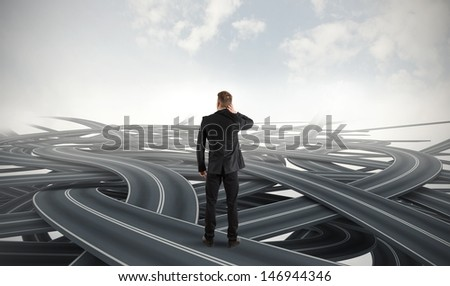 Difficult choices of a businessman due to crisis - stock photo