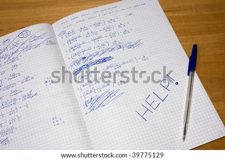 difficulties to resolve  exercise of mathematics,  student gives up and writes help - stock photo