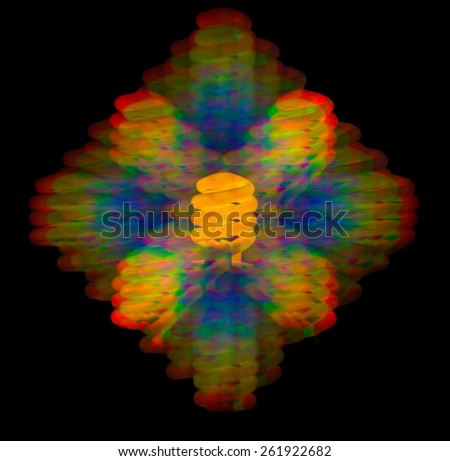 Diffraction of light from fluorescent energy saving lamp warm glow on the grating - stock photo