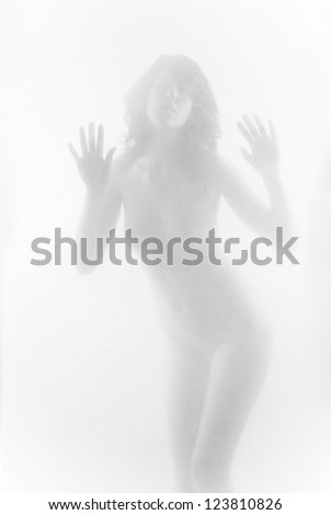 diffuse sexy woman in the smoke. Looking  closely through the scratched glass
