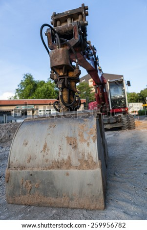 Digger in a roadwork construction site. - stock photo
