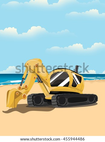 Digger on a sandy beach with the ocean in the background.