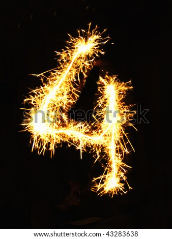 Digit 4 made of sparklers - stock photo