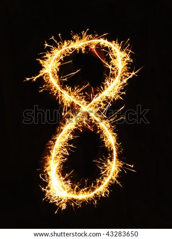 Digit 8 made of sparklers - stock photo