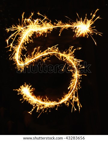 Digit 5 made of sparklers - stock photo