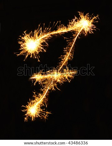 Digit 7 made of sparklers - stock photo