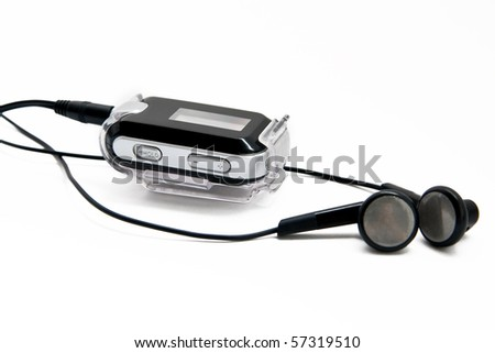 Digital audio player with headphones on white background - stock photo