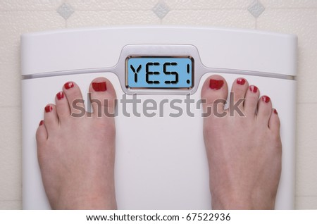 Digital Bathroom Scale Displaying YES Message - stock photo