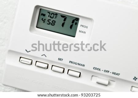 digital beige thermostat isolated on white background - stock photo